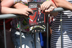 An Arsenal fan with a programme during the pre-season match at Meadow Park, Boreham Wood.