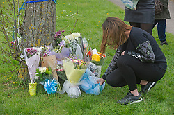 © Licensed to London News Pictures. 16/04/2019.<br /> Orpington, UK.Lighting a candle, Flowers and balloons have been placed at the scene of Saturday nights RTC by friends and family. An Eleven year old school boy called Josh was struck by a car while crossing Court road in Orpington, South East London, He was taken to hospital with critical injuries but has sadly died. Photo credit: Grant Falvey/LNP