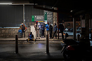 Migrants wait for the night bus that would take them to France. Irun (Basque Country). March 11, 2021. As the number of migrants arriving on the coasts of southern Spain incresead, more and more migrants are heading north to the border city of Irun on their way to reach France, Belgium or other European countries, but the controls of the French police make it difficult for them to pass. (Gari Garaialde / Bostok Photo)