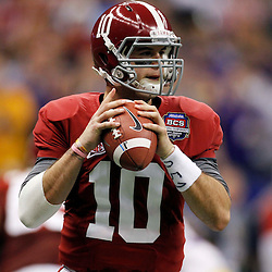 Jan 9, 2012; New Orleans, LA, USA; Alabama Crimson Tide quarterback A.J. McCarron (10) drops back to pass during the first half of the 2012 BCS National Championship game against the LSU Tigers at the Mercedes-Benz Superdome.  Mandatory Credit: Derick E. Hingle-US PRESSWIRE