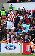Geoff Cameon of Stoke city (l) wins a header .Premier league match, Stoke City v West Ham Utd at the Bet365 Stadium in Stoke on Trent, Staffs on Saturday 29th April 2017.<br /> pic by Bradley Collyer, Andrew Orchard sports photography.