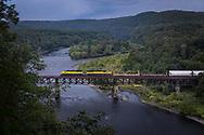 Sesquehanna train SU-99 crosses the Delaware River at Mill Rift, Pennsylvania.