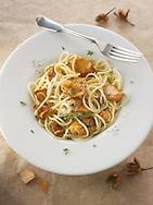Cooked wiild organic Pied de Mouton Mushrooms (hydnum repandum) or hedgehog mushroom with spaghetti