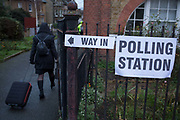Voting arrive at the church of St. Saviours in the south London borough of Lambeth, serving as a polling station for the UKs General Election 2 weeks before Christmas, on 12th December 2019, in London, England.