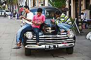 Young Indonesian men on their wireless phones.<br /> Various scenes of the city of Jakarta in Indonesia.