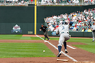 Milwaukee Brewers center fielder Nyjer Morgan bunts against the Minnesota Twins at Target Field in Minneapolis, Minnesota on June 17, 2012.  The Twins defeated the Brewers 5 to 4 in 15 innings.  The game was the longest in Target Field history.  © 2012 Ben Krause