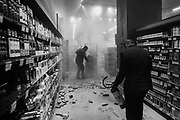 Employees douse a fire set by protesters inside a Carrefour supermarket in São Paulo during a protest against the murder of black man Joao Alberto Freitas at a different Carrefour supermarket the night before, on Brazil's National Black Consciousness Day. Freitas died after being beaten by supermarket security guards in the southern Brazilian city of Porto Alegre.