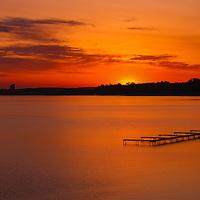 """Grand Traverse Sunrise""<br /> <br /> Deep orange skies at sunrise over Grand Traverse Bay!"