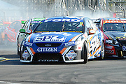 Shane Van Gisbergen locks up the brakes coming into the first corner of  Race 5 of the ITM 400 Hamilton,Hamilton Street Circuit, Day Two, Hamilton City ,V8 supercars,, Photo: Dion Mellow / photosport.co.nz