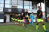 players and officials walk out ahead of k/o. The Emirates FA Cup, 2nd round match, Newport County v Cambridge United at Rodney Parade in Newport, South Wales on Sunday 3rd December 2017.<br /> pic by Andrew Orchard,  Andrew Orchard sports photography.