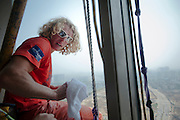 CHANGSHA, CHINA - SEPTEMBER 15: (CHINA OUT) <br /> <br /> Man Climbs On Glass Wall In Changsha<br /> <br />  24 - year - old Austrian climber Michael Kemeter takes a break while climbing the tallest skyscraper of Changsha on September 15, 2013 in Changsha, Hunan Province of China. It took Michael one hour to climb from the ground to the 45th floor, reaching a height of about 200 meters, without any protective measures. <br /> ©Exclusivepix