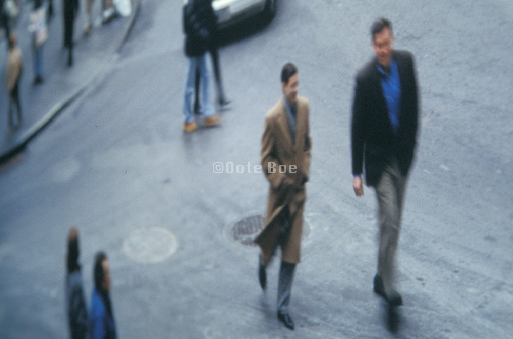 two businessmen walking along a city street. New York NY.