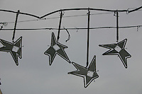 Star shaped Christmas lights decorating the streets of Barcelona, Spain<br />