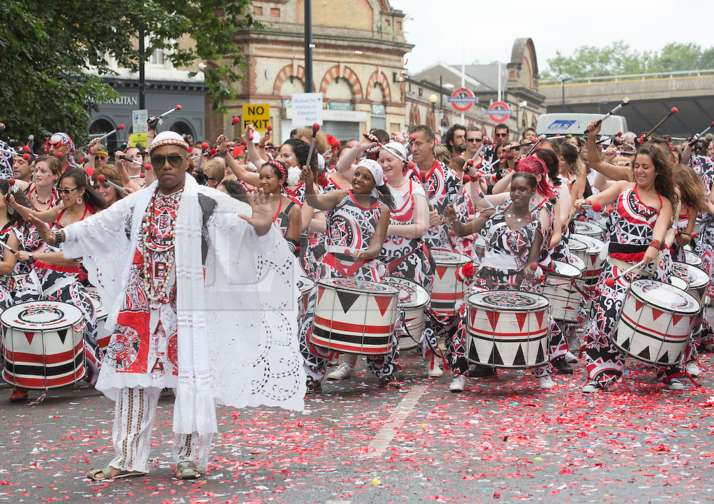 """© Licensed to London News Pictures. 27/08/2012 London, England. Pictured: Drummers from the group """"Batala"""". Notting Hill Carnival 2012, the largest street festival in Europe, gets its parade on Adults' Day under way. Photo credit: Bettina Strenske/LNP"""