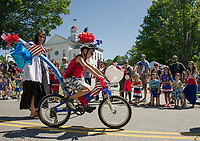 Zach Osman rides his fully decked out 4th of July bicycle during Gilmanton's parade on Tuesday morning.  (Karen Bobotas/for the Laconia Daily Sun)