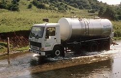 Lorry driving through flood water,