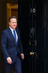 © Licensed to London News Pictures. 13/05/2016. London, UK. Prime Minister David Cameron walking out to welcome Chilean President Michelle Bachelet in Downing Street, London on Friday, 13 May 2016. Photo credit: Tolga Akmen/LNP