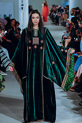 © Licensed to London News Pictures. 18/02/2017. London, UK.  A model presents a look by Art of Heritage (Saudi Arabia) at the UK's first London Modest Fashion Week taking place this weekend at the Saatchi Gallery.  The two day event sees 40 brands from across the world come together to showcase their collections for Muslim and other religious women. Photo credit : Stephen Chung/LNP