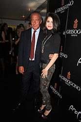SELENA GOMEZ and FAWAZ GRUOSI at the launch party for 'Promise', a new capsule ring collection created by Cheryl Cole and de Grisogono held at Nobu, Park Lane, London on 29th September 2010.