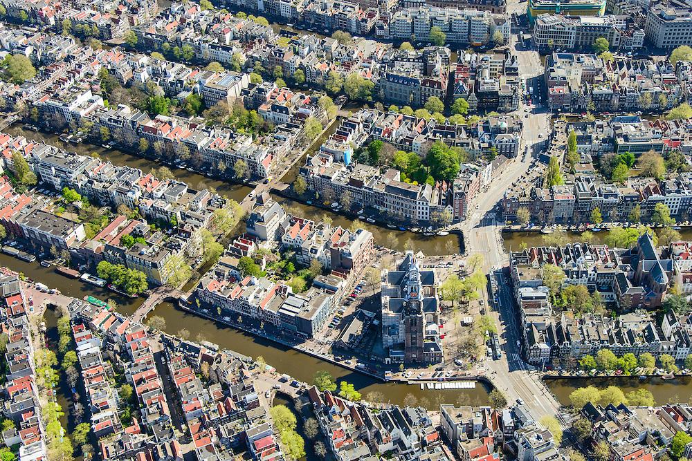 Nederland, Noord-Holland, Amsterdam, 09-04-2014;<br /> Binnenstad en grachtengordel, vbnb Prinsengracht, Keizersgracht, Herengracht, Singel doorsneden door de Raadhuisstraat.<br /> Aan de Prinsengracht Anne Frankhuis (Achterhuis), Westertoren, Westermarkt.<br /> Center and ring of canals of Amsterdam. <br /> The Westerkerk (church) next  to the Achterhuis (now Anne Frank House)  where people are queueing.<br /> luchtfoto (toeslag op standard tarieven);<br /> aerial photo (additional fee required);<br /> copyright foto/photo Siebe Swart