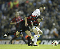 Photo Aidan Ellis.<br />Leeds United v Huddersfield Town.<br />Coca-Cola cup Round 1.<br />24/08/2004.<br />Huddersfield's Chris Brandon battles with Leeds Frazer Richardson