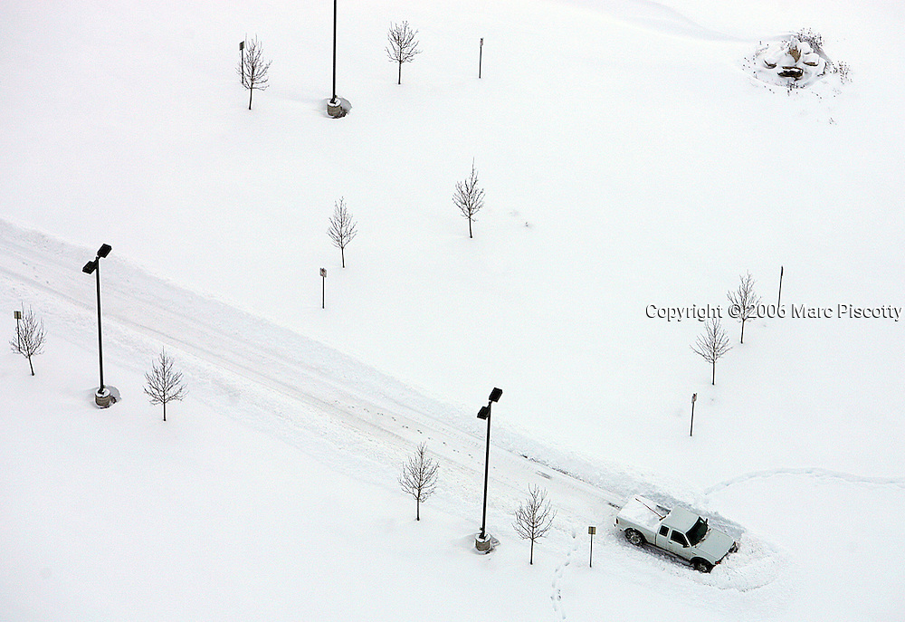 A lone truck sits parked at the end of a plowed drive unable to make it any further in the deep snow near Castle Rock. Aerial photographs along the I-25 corridor from Centennial to Greeneland of the effects of a slow moving winter blizzard that left as much as two feet of snow on the ground around the Denver area. Heavy snowfall and blowing winds have caused widespread closures and cancellations around Denver as a slow moving snow storm made its way through the area Thursday December 21, 2006. The snow started falling early Wednesday and finally started to taper off mid-day Thursday with as much as two feet of snow on the ground around the Denver area. I-25 was still closed from Lincoln Ave. to Colorado Springs at the time of the photographs but was later opened the entire way from Wyoming to New Mexico..(MARC PISCOTTY/ © 2006).