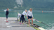 Aiguebelette, FRANCE.  left coach Nick STRANGE look's on as the GBR W4X boat [Bow. Beth RODFORD, Lucinda GOODERHAM, Kristina STILLER and Victoria MEYER-LAKER] prepare for their early morning training session, at the 2014 FISA World Cup II, 06:33:36  Saturday  21/06/2014. [Mandatory Credit; Peter Spurrier/Intersport-images]