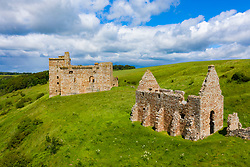 Elevated view of 14th century Crichton Castle and stables  in Midlothian, Scotland, UK