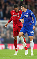 Liverpool defender Joe Gomez (12) wins a header over Chelsea forward Alvaro Morata (29) during the Premier League match between Chelsea and Liverpool at Stamford Bridge, London, England on 29 September 2018.