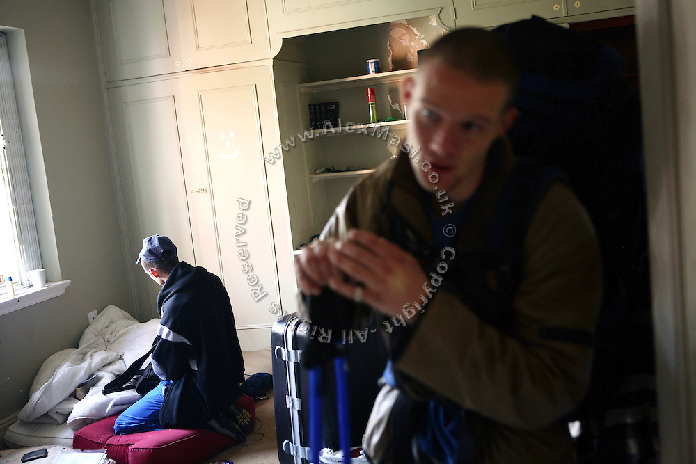 Pete, 23, (right) from Lincolnshire, is ready to leave his room in the Ingram Avenue mansion for good, while Lee, 26, (left) from West London, is on his knees packing the last items up, on Saturday, Oct. 20, 2007, in Hampstead, London, England. The 22-room mansion was last sold for UK£ 3.9M in 2002 and is now awaiting planning permissions to be demolished. Two new houses will soon be taking its place. Million Dollar Squatters is a documentary project in the lives of a peculiar group of squatters residing in three multi-million mansions in one of the classiest residential neighbourhoods of London, Hampstead Garden. The squatters' enthusiasm, their constant efforts to look after what has become their home, their ingenuity and adventurous spirit have all inspired me throughout the days and nights spent at their side. Between the fantasy world of exclusive Britain and the reality of squatting in London, I have been a witness to their unique story. While more than 100.000 properties in London still lay empty to this day, squatting provides a valid, and lawful alternative to paying Europe's most expensive rent prices, as well as offering the challenge of an adventurous lifestyle in the capital.