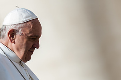 Pope Francis leaves at the end of the wednesday general audience in Saint Peter's square at the Vatican.