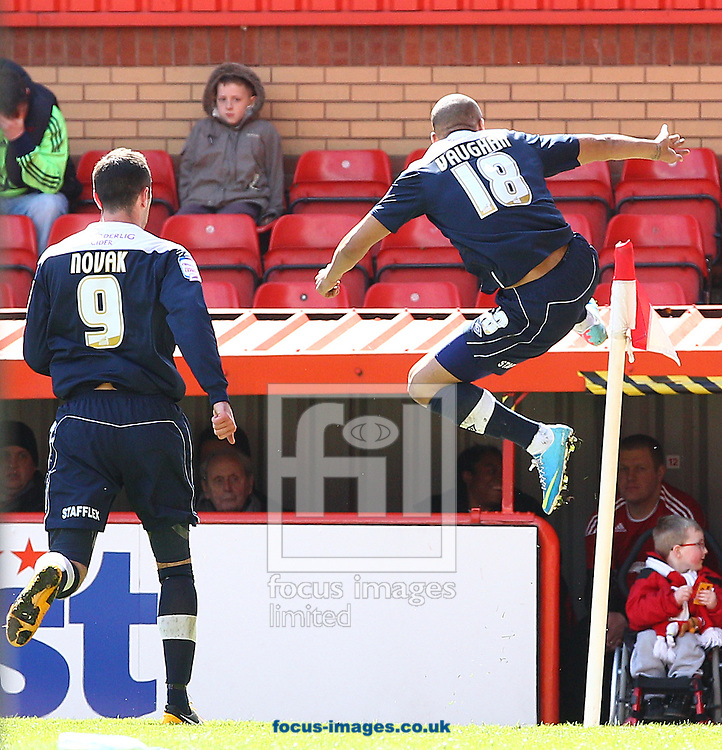 Picture by Paul Terry/Focus Images Ltd +44 7545 642257.27/04/2013.James Vaughan ( R ) of Huddersfield Town celebrates after he scores his second goal to make it 2-0 during the npower Championship match at Ashton Gate, Bristol.