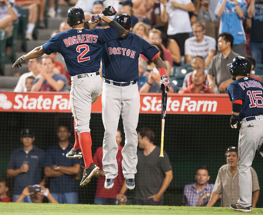 The Red Sox' Xander Bogaerts celebrates with David Ortiz after his two-run home run in the seventh inning during the Angels' 6-2 loss to the Boston Red Sox at Angel Stadium on Friday.<br /> <br /> ///ADDITIONAL INFO:   <br /> <br /> angels.0730.kjs  ---  Photo by KEVIN SULLIVAN / Orange County Register  -- 7/29/16<br /> <br /> The Los Angeles Angels take on the Boston Red Sox at Angel Stadium.