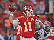 KANSAS CITY, MO - OCTOBER 20:  Quarterback Alex Smith #11 of the Kansas City Chiefs throws a pass against the Houston Texans during the first half on October 20, 2013 at Arrowhead Stadium in Kansas City, Missouri.  (Photo by Peter Aiken/Getty Images) *** Local Caption *** Alex Smith