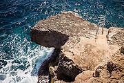 Calo de sa barca trencada, Mallorca, Ladder at the abandoned cliffs.