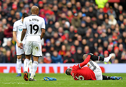 Manchester United's Paul Pogba loses a boot after a tackle