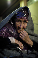 Fatima, age 96, from Mazar-i-Sharif, Afghanistan. Accompanied by her grandkids and others, she rode a horse to the Iranian border, bused across Iran and Turkey, and on the morning this photo was taken took a crowded boat from Turkey to Lesvos during a thunderstorm. Here she is in the port of Mytilene, waiting for a 1:00 a.m. ferry for Athens.