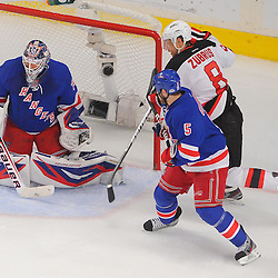 May 14, 2012: New York Rangers goalie Henrik Lundqvist (30) makes a blocker save with defenseman Dan Girardi (5) and New Jersey Devils right wing Dainius Zubrus (8) in front during first period action in game 1 of the NHL Eastern Conference Finals between the New Jersey Devils and New York Rangers at Madison Square Garden in New York, N.Y.