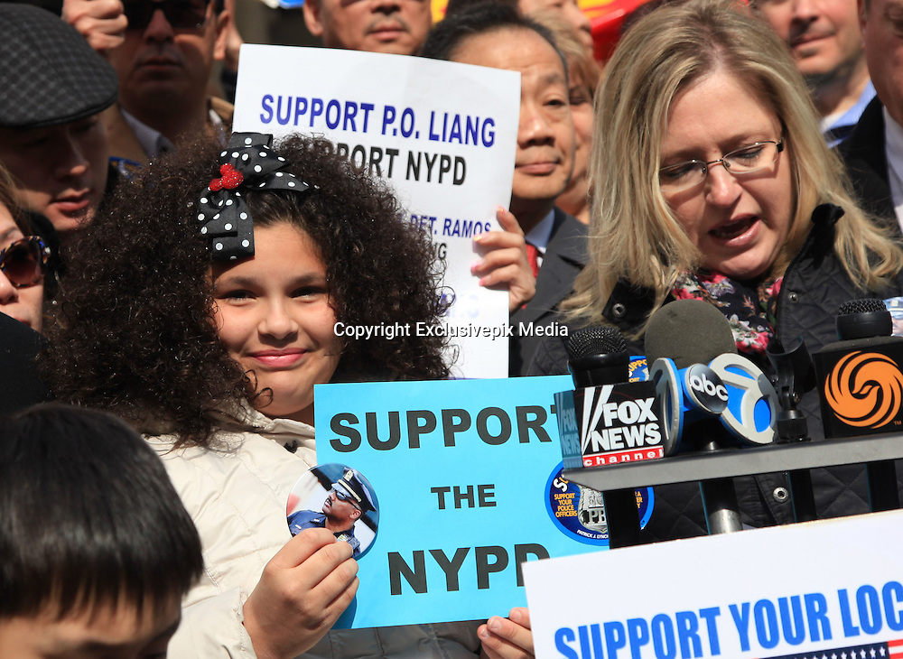 Ethnic Chinese Citizens Support NYPD<br /> <br /> Large groups of ethnic Chinese citizens come to New York City Hall support NYPD and required to treat ethnic Chinese policeman Peter Leung fairly in New York, America on 08 March, 2015.<br /> ©Exclusivepix Media
