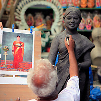 Asia, India, Calcutta. Clay artist sculpts from photograph in the potter's village of Kumartuli in Calcutta.