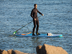© Licensed to London News Pictures. 02/10/2016. Southsea, Hampshire, UK.  A man on a paddle board enjoying the last of the evening light on what has been another warm and sunny autumn day in the South of England. Photo credit: Rob Arnold/LNP