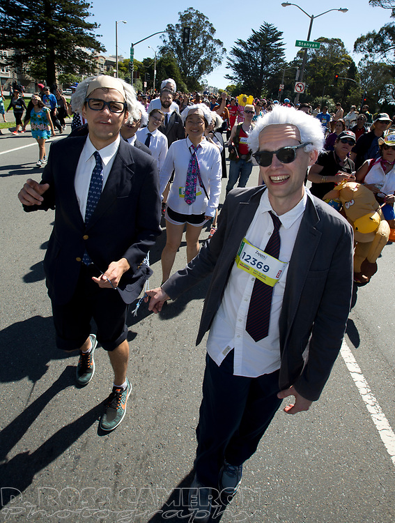 A group of runners costumed as Democratic presidential candidate Bernie Sanders pass through Golden Gate Park, during the 105th running of the Bay to Breakers 12k, Sunday, May 15, 2016 in San Francisco. The 7.42-mile race from San Francisco Bay to the Pacific Ocean, which attracts a field of tens of thousands of runners, from elite runners to weekend warriors, some clad in costume and some in nothing at all. (Photo by D. Ross Cameron)