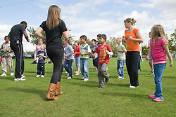 Dance teachers showing a group of children some new steps at a Parklife summer activities event,