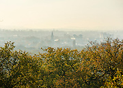 © Licensed to London News Pictures. 04/11/2014. Richmond, UK. Mist hangs over Kingston Upon Thames. People and animals enjoy the warm sunshine in Richmond Park, Surrey today 4th November. Britain has experienced unseasonably warm weather recently.  Photo credit : Stephen Simpson/LNP