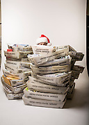 """Gabby Gaborik, Chief Elf who answers letters to """"Santa Claus"""", in North Pole, Alaska. Seen here with some of the many thousands of letters he and other volunteers respond to each year.  Photographed in North Pole, Alaska  by Brian Smale, for People Magazine."""