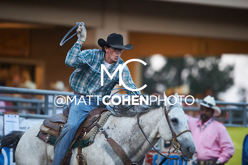 Team roper Cole Dorenkamp of Lamar, CO competes at the Pikes Peak or Bust Rodeo in Colorado Springs, CO.<br /> <br /> <br /> UNEDITED LOW-RES PREVIEW<br /> <br /> <br /> File shown may be an unedited low resolution version used as a proof only. All prints are 100% guaranteed for quality. Sizes 8x10+ come with a version for personal social media. I am currently not selling downloads for commercial/brand use.