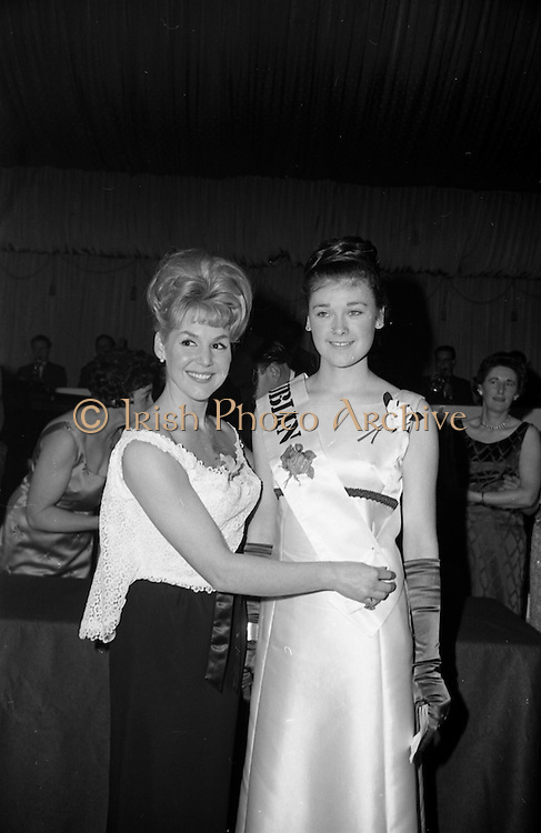 28/04/1965<br /> 04/28/1965<br /> 28 April 1965<br /> Festival of Kerry Dublin Ball at the Gresham Hotel, Dublin. Photo shows winner Miss Irene Courtney (right) receiving her award as Dublin Rose, from Frances McDermott (Judge).