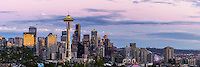 The viewpoint from Kerry Park in Seattle provides a sweeping vista overlooking the Space Needle and downtown Seattle at sunset.