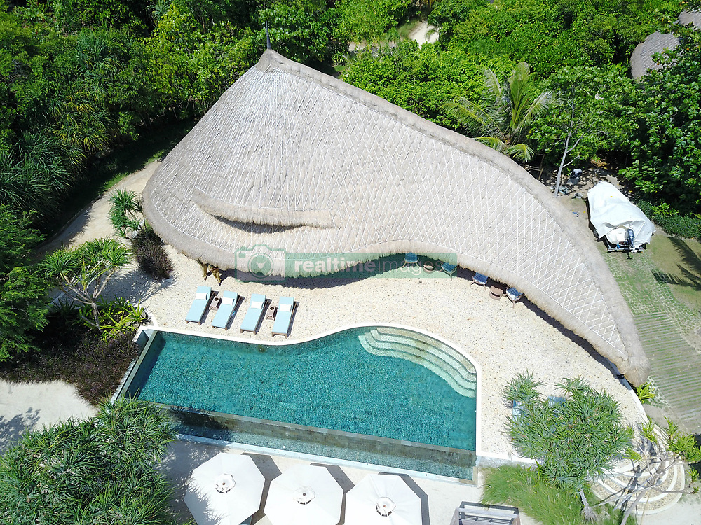 April 25, 2017 - Cempedak, Indonésie - 25/04/2017 - A stunning private island resort is offering Robinson ruwo3-wstyle chalets made from bamboo and topped with thatched grass roofing.But the pictures, fittings and amenities on Cempedak in Indonesia , are anything but desert island basic.It offers amazing luxury and facilities with prices from $600 USD / 550 Euros / £470 GBP per room per night excluding board and drinks.Cempedak,which opened in March, is described as a unique private island with sustainability at theforefront of its ground-breaking design. It is reached only by private speed with the island's stunning hand-crafted bamboo villas just visible through the natural jungle-foliage.It has room for a maximum of 40 guests with an adults only policy.There are no televisions at the resort which has been slowly developed over several years to preserve the natural habitat and wildlife and where guests are encouraged to go barefoot.The name comes from the native Indonesian fruit tree. Local villagers initially explained to the owners that the island was renowned for the quality of its Cempedak.The owners of Cempedak also own neighbouring Nikoi island which was developed a few years previously.Impressed at the natural and unspoilt beauty of the area they acquired the titles to Nikoi Island in 2004. It was uninhabited - a true deserted island. Disenchanted with the standard of holiday accommodation on offer within close range of Singapore the owners set about developing the island to suit their ideal holiday destination.Nikoi Island opened in May 2007. In 2011 the title to Cempedak Island was acquired A spokesman said: The approach to developing it was to make it a sustainable venture in all respects. 'With the experience from the build of Nikoi Island they have been able to make improvements to the sustainability of the development.'The owners have deliberately tried to create a product outside of the mould of the cookie- cutter hotel model - a box with a che