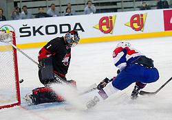 Masahito Haruna of Japan vs Ziga Jeglic of Slovenia during ice-hockey match between Slovenia and Japan at IIHF World Championship DIV. I Group A Slovenia 2012, on April 16, 2012 in Arena Stozice, Ljubljana, Slovenia. Slovenia defeated Japan 4-2. (Photo by Vid Ponikvar / Sportida.com)